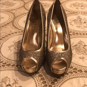 Guess Shoes - Guess gold sparkle heels. Never worn. Like new.